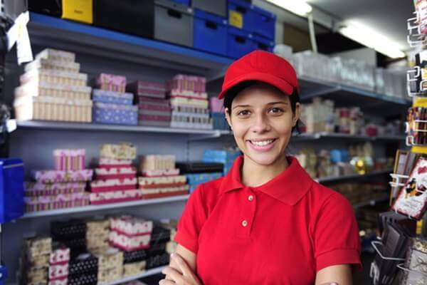 corporate uniforms: woman wearing red polo shirt and hat