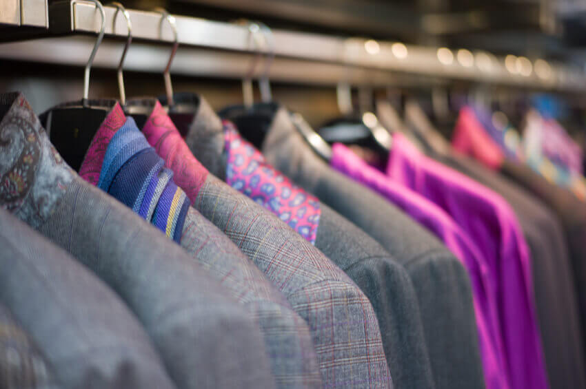 corporate suits: close up of a row of jackets on a hanging rail