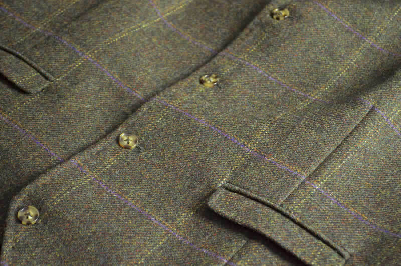 close up of fabric detail on The Coaching Inn uniform (waistcoat)