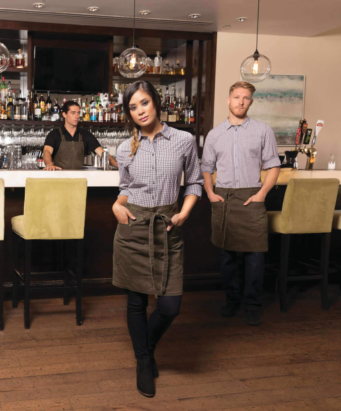 Chefworks uniform collection: two men and a woman in bar