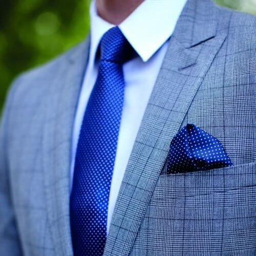 corporate clothing: close up of man in grey jacket with matching tie and pocket square