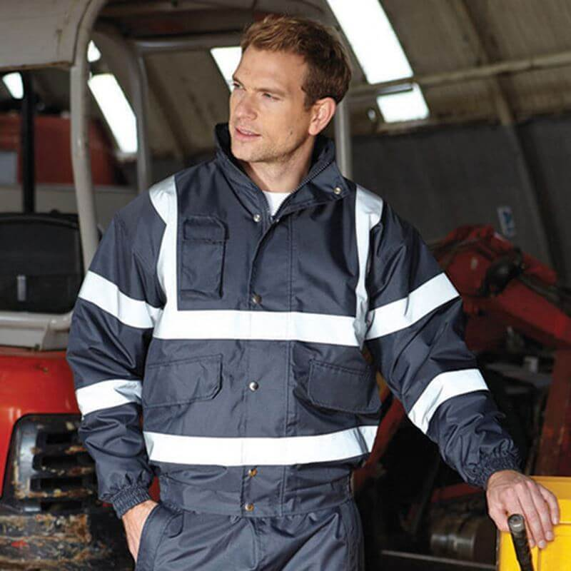 ppe workwear - man in hi vis navy jacket